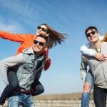 Happy teenage friends having fun outdoors — Stock Photo #77611938