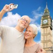 Senior couple taking selfie on camera over big ben — Stock Photo #77920456