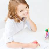 Little student girl drawing at school — Stock Photo