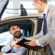 Happy man with car dealer in auto show or salon — Stock Photo #78205480