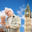 Senior couple with map over london big ben tower — Stock Photo #78624132
