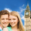 Happy couple over big ben tower in london — Stock Photo #78624528