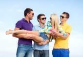 Group of friends having fun on beach — Stock Photo