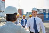 Builders making handshake on construction site — Stock Photo