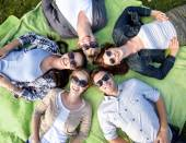 Group of students or teenagers lying in circle — Stock Photo