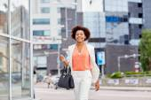 Happy young african american businesswoman in city — Stock Photo