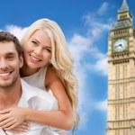 Happy couple hugging over london big ben tower — Stock Photo #79047298