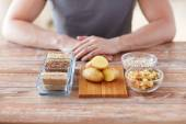 Close up of male hands with carbohydrate food — Stock Photo