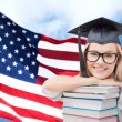 Happy student girl with books over american flag — Stock Photo #79252556