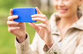 Close up of woman taking picture with smartphone — Stock Photo