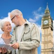 Senior couple with map over london big ben tower — Stock Photo #79383134
