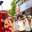 Friends taking selfie with smartphone in london — 图库照片 #79383400