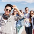 Teenage boy with sunglasses and friends outside — Stock Photo #79487622