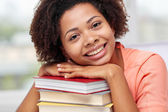 Happy african student girl with books at home — Стоковое фото