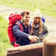 Smiling couple with backpacks hiking — Stock Photo #79932564