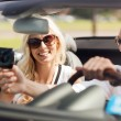 Happy couple usin gps navigation system in car — Stock Photo #80045838