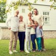 Happy family in front of house outdoors — Stock Photo #80612336