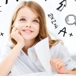 Little student girl studying at school — Stock Photo #80947688