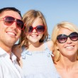 Happy family with blue sky — Stock Photo #80948042