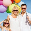 Family with colorful balloons — Stock Photo #80948124