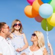 Family with colorful balloons — Stock Photo #80948174