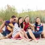 Group of happy friends having fun on beach — Stock Photo #81161652