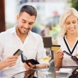 Couple with credit cards paying bill at restaurant — Stock Photo #81163754