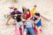Group of happy friends having fun on beach — Stock Photo