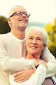 Senior couple hugging in park — Stock Photo