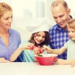 Happy family with two kids making dinner at home — Stock Photo #81600880