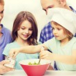 Happy family with two kids eating at home — Stock Photo #81600894