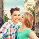Happy couple taking selfie over city background — Stock Photo #81600934