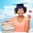 Happy african bachelor girl with books and diploma — Stock Photo #81601486