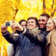 Group of smiling men and women making selfie — Stock Photo #81692268