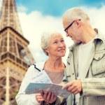 Senior couple on city street — Stock Photo #81692864