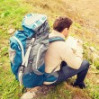 Man with backpack hiking — Stock Photo #81692982