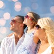 Happy family over blue lights background — Stock Photo #81693470