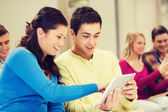 Group of smiling students with tablet pc — Stock Photo