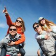 Happy friends in shades having fun outdoors — Stock Photo #81910404