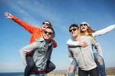 Happy friends in shades having fun outdoors — Stock Photo