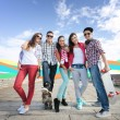 Teenagers with skates outside — Stock Photo #82028230
