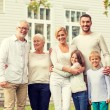 Happy family in front of house outdoors — Stock Photo #82262678