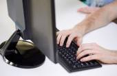 Close up of male hands with laptop typing — Stock Photo