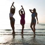 Happy female friends dancing on beach — Photo #82936666