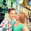 Couple kissing and taking selfie over city street — Stock Photo #83121066