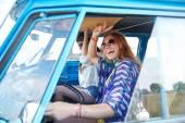 Smiling young hippie women driving minivan car — Stock Photo