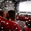 Happy friends or couple watching movie in theater — Stok fotoğraf #85129384