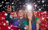 Happy couple watching movie in theater — Stock Photo
