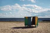 Wooden cubicle changing rooms on beach — Stock Photo