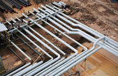 Steel pipes on a newly industrial enterprises — 图库照片